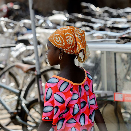 Young woman with beautiful coloured dress in Dakar, Senegal: Urban Yellow Fever is an ongoing risk in West Africa